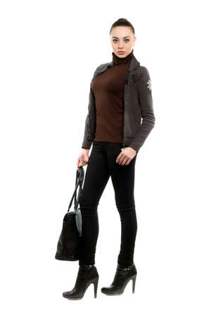Attractive young brunette dressed in casual style with a bag. Isolated on white    photo