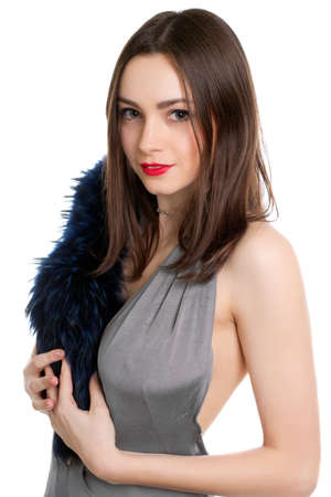 Portrait of pretty brunette posing with fur. Isolated on white