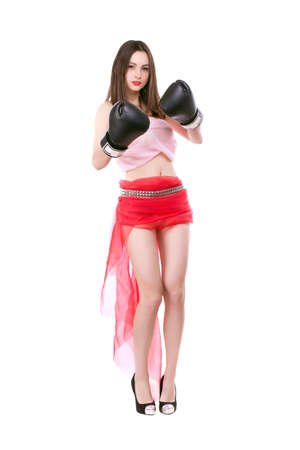 Cheeky young brunette wearing trendy clothes and boxing gloves. Isolated on white photo