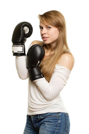 Playful young woman with black boxing gloves. Isolated on white  photo