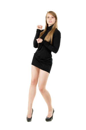 Attractive blond lady posing in black short dress. Isolated on white photo