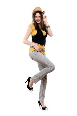 stetson: Young smiling brunette in stetson standing on one leg. Isolated on white Stock Photo