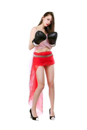 Sexy young lady posing in red skirt and boxing gloves. Isolated on white photo