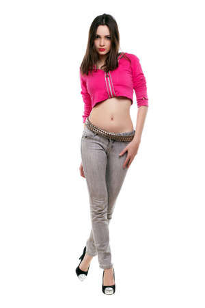 Young Attractive Lady Posing In Short Pink Jacket And Grey Jeans ...