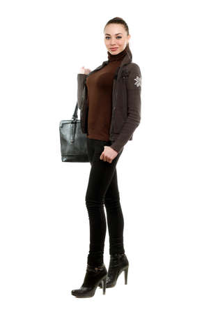 Attractive young woman with a bag wearing black pants and shoes. Isolated on white   photo