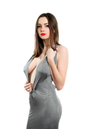 Young alluring lady wearing sexy grey dress. Isolated on white Stock Photo - 18493780