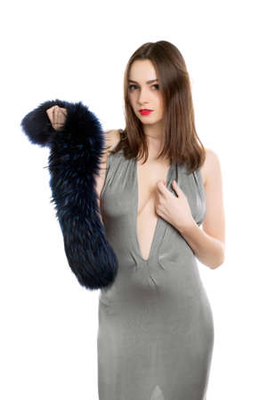 Pretty brunette wearing elegant grey dress with fur. Isolated on white Stock Photo - 18493842