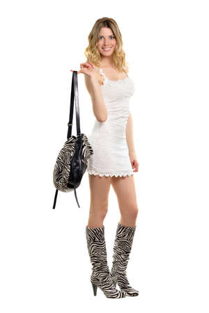 Joyful young woman dressed in the colors of zebra boots. Isolated on white