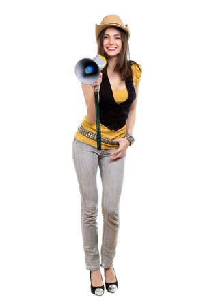 Smiling brunette with a loudspeaker wearing grey jeans and stetson. Isolated on white photo