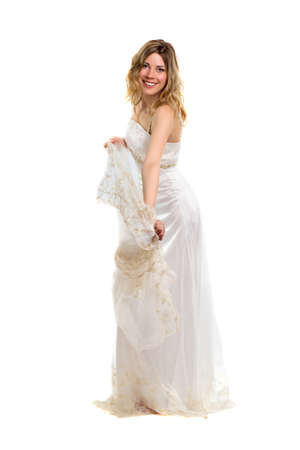 Playful young smiling blonde posing in white wedding dress. Isolated photo