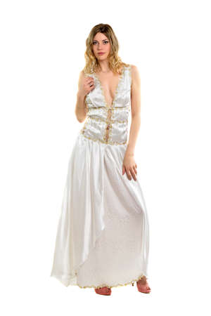 Seductive blonde wearing white evening dress and pink shoes. Isolated photo