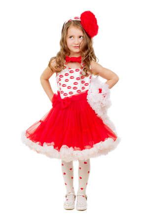 little girl posing: Beautiful little girl posing in red and white lace dress with big bow. Isolated