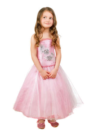 Funny little girl posing in nice pink dress. Isolated on white Stock Photo