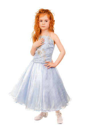 Cute little girl posing in nice blue dress. Isolated on white photo
