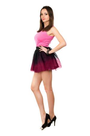 leggy girl: Alluring leggy brunette posing in short skirt. Isolated on white Stock Photo