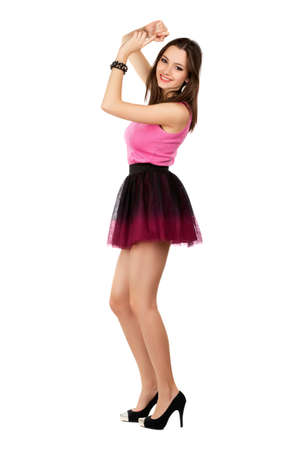 pleated: Pretty smiling woman wearing short frank skirt. Isolated on white  Stock Photo