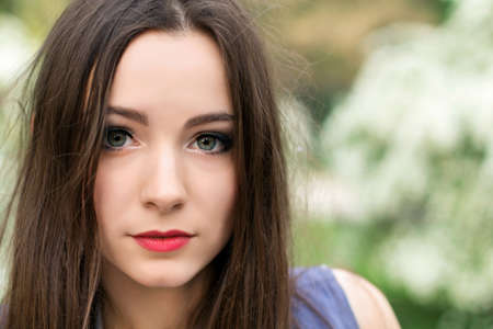 Portrait of young brunette with big alluring eyes photo