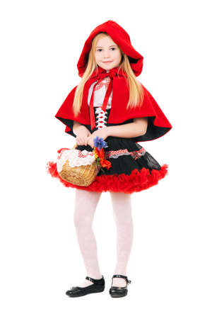Little blond girl dressed as little red riding hood with basket. Isolated on white  Stock Photo
