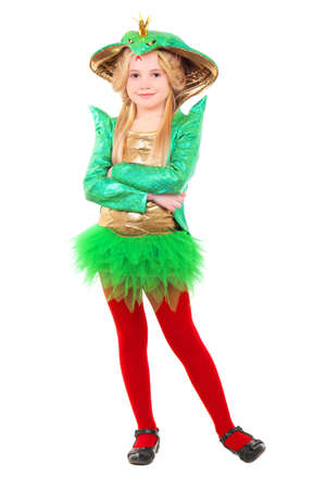 Little blond girl wearing green carnival costume. Isolated on white  photo