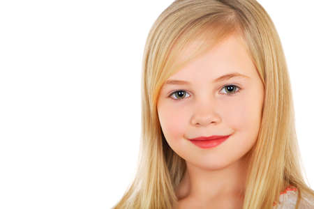 Portrait of little blond girl with charming smile. Isolated on white