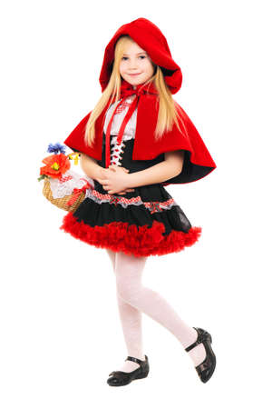 Little girl posing dressed as little red riding hood with basket. Isolated on white