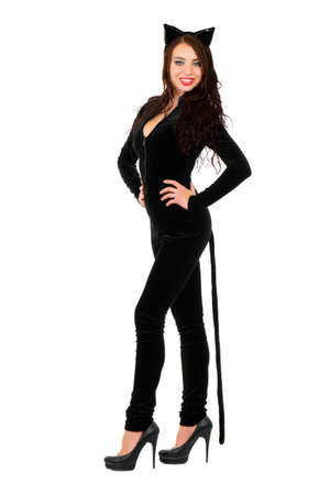 Young smiling woman posing in black catsuit. Isolated on white  photo