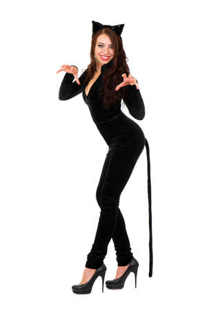 Sexy playful woman posing in black catsuit. Isolated on white. photo