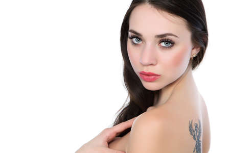 Portrait of sexy naked brunette with a firebird tattoo. Isolated on white  photo