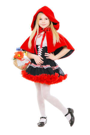 Blond cute girl posing in red costume with basket. Isolated on white
