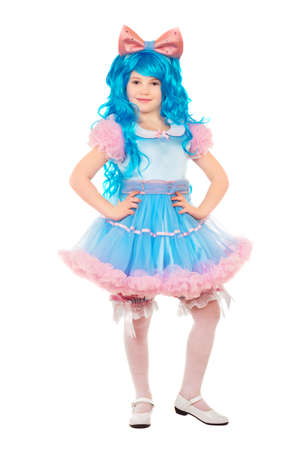 Positive little girl posing wearing luxury dress and blue wig. Isolated on white  photo