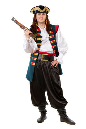 Young man in pirate costume posing with a pistol. Isolated on white  photo