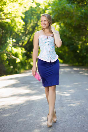 Nice trendy woman walking on the road photo