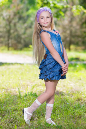Nice little girl wearing blue jeans dress photo