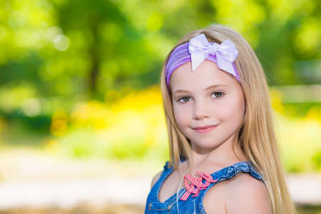 little girl posing: Portrait of pretty little girl posing outside Stock Photo