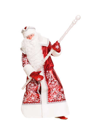 Playful Santa Claus posing with a staff. Isolated on white photo