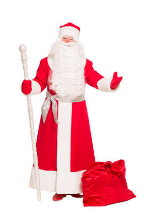 Santa Claus with gift bag. Isolated on white photo