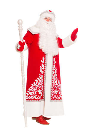 Santa Claus posing with a staff. Isolated on white photo