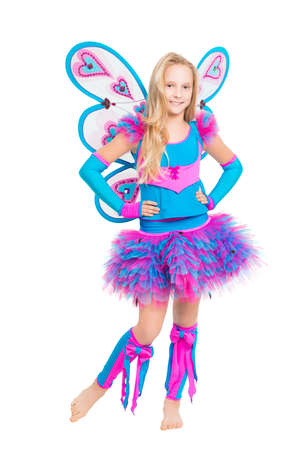 Blond barefooted girl posing in fairy costume. Isolated on white photo