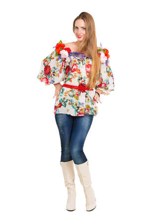 Smiling young woman posing in flowery blouse. Isolated on white photo