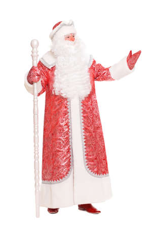 Man wearing red costume of Santa Claus. Isolated on white photo