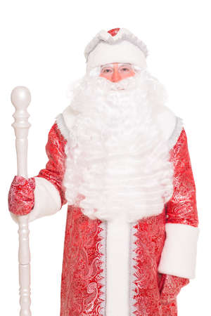 Portrait of Santa Claus with a staff. Isolated on white photo