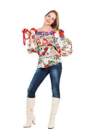 Sexy playful woman posing in flowery blouse. Isolated on white photo