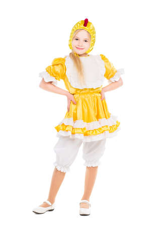 Funny little girl dressed like a chicken. Isolated on white photo