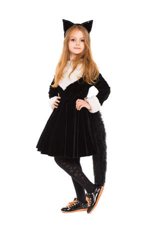 Attractive little girl dressed in black catsuit. Isolated on white photo