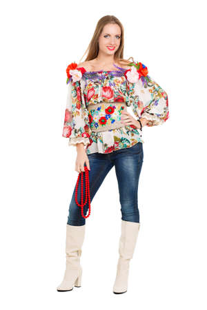 Sexy cheerful woman posing in flowery blouse and boots. Isolated on white photo