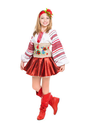 Happy little girl wearing Ukrainian national clothes. Isolated on white photo