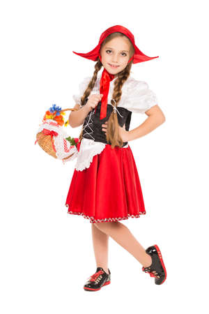 Girl dressed as little red riding hood with basket. Isolated on white Stock Photo
