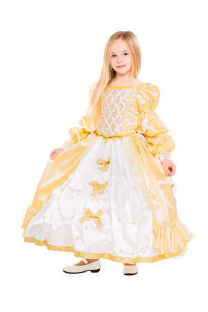 Little blond girl in a chic golden dress. Isolated on white