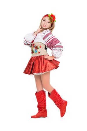 Smiling little blonde wearing Ukrainian national clothes. Isolated on white photo