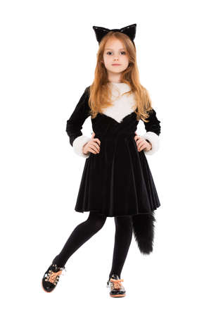 Nice little girl dressed as black cat. Isolated on white photo
